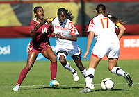 COLLEGE PARK, MD - OCTOBER 21, 2012:  Shade Pratt (22) of the University of Maryland keeps Tiffany McCarty (14) of Florida State away from the ball during an ACC women's match at Ludwig Field in College Park, MD. on October 21. Florida won 1-0.