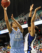 Chay Shegog shoots over Duke's Krystal Thomas. This was the Championship game of the 2011 ACC Tournament in Greensboro on March 6, 2011. Duke beat UNC 81-66. (Photo by Al Drago)