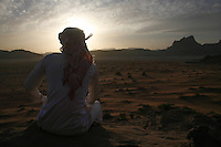 A Bedouin man lokks at the sunset in Wadi Rum Jordan, may 14, 2013. Photo by Oren Nahshon