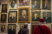 Visitors look at artifacts from Hungary's socialist past found in the basements of different ministries after a change in political power. These communist pictures and sculptures are now being prepared for a charity auction to support those affected by the recent red sludge catastrophe in hungary. The auction drawing great attention from around the world is to be held on december 6th in Budapest, Hungary, on  December 06, 2010. ATTILA VOLGYI