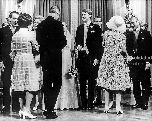Washington, DC - June 12, 1971 -- United States Vice President Spiro T. Agnew and his wife, Judy, congratulate newlyweds Tricia Nixon Cox and Edward Cox following their wedding ceremony in the Rose Garden of the White House in Washington, D.C. on Saturday, June 12, 1971.   Seen in the receiving line from left to right: United States President Richard M. Nixon; first lady Pat Nixon; Tricia Nixon Cox, Edward Cox; and Edward Cox, Sr., who is greeting former first lady Mamie Eisenhower..Credit: Pool via CNP