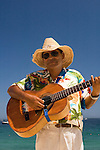 Beach musician on the beach (playa), Cabo San Lucas, Baja California, Mexico