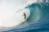 Local surfer Monoa Drollet (PYF) riding ones of the world's most infamous waves,TEAHUPOO, Tahiti .  Photo: Joliphotos.com