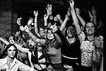 Paul and Linda McCartney Wings Tour 1975.  Ecstatic female fans scream and wave their arms, an impassive bouncer stands at their side. Bristol, England.