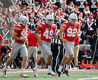 Ohio State Buckeyes place kicker Tyler Durbin (92) runs off the field with Ohio State Buckeyes long snapper Liam McCullough (49) and Ohio State Buckeyes punter Cameron Johnston (95) after kicking a field goal during the first quarter of the NCAA football game between the Ohio State Buckeyes and the Tulsa Golden Hurricane at Ohio Stadium on Saturday, September 10, 2016. (Columbus Dispatch photo by Jonathan Quilter)