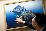 Lee Seokwoo, law professor at Inha University Law School, points at a photo of the disputed Dokdo Islands, known to Japanese as Takeshima, at  the Northeast Asian History Foundation offices in Seoul, South Korea on on 21 June 2010..Photographer: Robert Gilhooly.