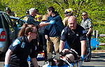 """WOODBURY,  CT-051717JS01- Woodbury police officer Frans Dielemans """"detains"""" driver Javis Berry, a senior at Nonnewaug High School, on suspicion of drunk driving, during a mock crash event Wednesday the school in Woodbury.  The event was held to remind students how prom night and graduations parties can turn into tragedy. Participating in the drill were, Nonnewaug High School students,  Woodbury police, fire and ambulance crews as well as resident state trooper Sgt. Joe Roden and Munson-Lovetere Funeral Home.  The cars used in the mock crash were provided by Shakers of Woodbury. Jim Shannon Republican-American"""