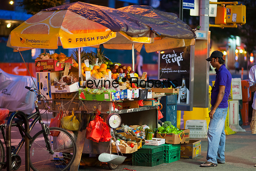 A 24 hour fruit and vegetable stand in the Chelsea neighborhood of New York on the evening of Thursday, May 31, 2012.  (© Richard B. Levine)