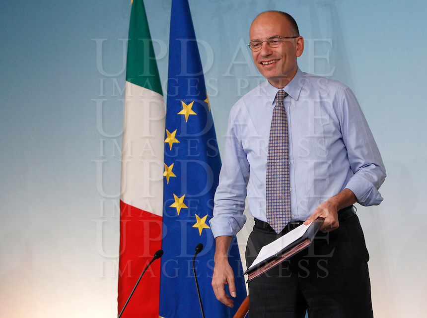 Il Presidente del Consiglio Enrico Letta sorride al termine di una conferenza stampa a Palazzo Chigi, Roma, 12 agosto 2013.<br /> Italian Premier Enrico Letta smiles at the end of a press conference at Chigi Palace, Rome, 12 August 2013.<br /> UPDATE IMAGES PRESS/Riccardo De Luca