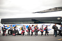 SAN JOSE, CA--The Stanford Cardinal line up to board a charter plane at Atlantic Aviation en route to Norfolk, VA for the first and second rounds of the 2012 NCAA tournament.
