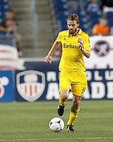 Columbus Crew forward Eddie Gaven (12) brings the ball forward. In a Major League Soccer (MLS) match, the New England Revolution defeated Columbus Crew, 2-0, at Gillette Stadium on September 5, 2012.