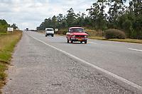 Cuba, Pinar del Rio Region, Viñales (Vinales) Area.  Highway A4 Motor Traffic.