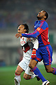 Keiji Yoshimura (Grampus), Lucas (FC Tokyo), MARCH 18, 2012 - Football / Soccer :2012 J.LEAGUE Division 1 between FC Tokyo 3-2 Nagoya Grampus at Ajinomoto Stadium, Tokyo,  Japan. (Photo by Atsushi Tomura /AFLO SPORT) [1035]