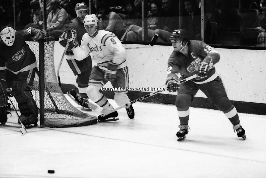 Detroit Red Wings Marcel Dionne, Seals #9Wayne Merrick or Larry Patey. (1975 photo by Ron Riesterer)