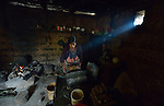 Audelina Vasquez Lopez, a Maya Mam woman, grinds corn for food in her home in Tuixcajchis, a small village in Comitancillo, Guatemala.
