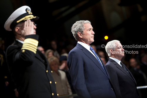 Arlington, VA - January 6, 2009 -- United States President George W. Bush, center, stands by Robert Gates, Secretary of Defense, right, and Admiral Michael Mullens, Chairman of the Joint Chiefs of Staff,  during the Military Appreciation Parade at Fort Myer in Arlington, Virginia, U.S. on Tuesday, January 6, 2009. Bush was awarded the Department of Defense Medal for Distinguished Public Service during the parade.      .Credit: Joshua Roberts - Pool via CNP