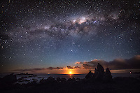As moon sets on the horizon to the west of Wellington, New Zealand, the stars and the Milky Way get brighter as the night sky darkens above.