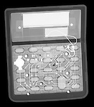 X-ray image of a wide calculator (white on black) by Jim Wehtje, specialist in x-ray art and design images.