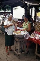 Woman buying bread in the Mercado Municipal, Masaya, Nicaragua