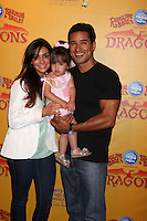 LOS ANGELES - JUL 12:  Courtney Mazza, Mario Lopez and their daughter arrives at 'Dragons' presented by Ringling Bros. & Barnum & Bailey Circus at Staples Center on July 12, 2012 in Los Angeles, CA