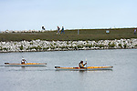 Tourists and visitors enjoying the Milwaukee Harbor Lake Front beach and peninsula and kayakers paddling in the bay