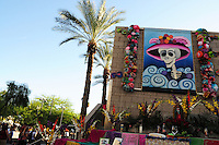 "Mesa, Arizona. October 28, 2012 - The Day of the Dead is a religious holiday celebrated in Mexico with a solemn mood to remember dead loved ones. However, in the Southwest of the United States and in states like Arizona, the holiday takes a form of a cultural festivity, the turning the traditional ""Día de los Muertos"" into a festival-like event. The ""Día de los Muertos"" Celebration takes place every year at the Mesa Arts Center, in the city of Mesa, Arizona. The annual event attracts hundreds of visitors who have roots in the religious holiday or attracted by the colorful and festive aspect. Photo Eduardo Barraza © 2012"