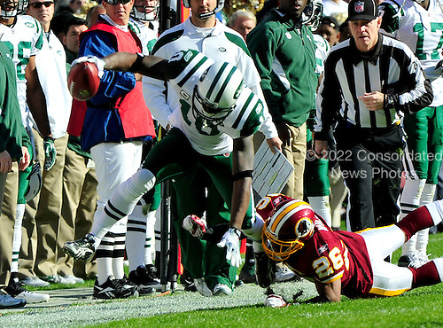 New York Jets wide received Santonio Holmes (10) makes a catch over Washington Redskin cornerback Josh Wilson (26) at FedEx Field in Landover, Maryland on Sunday, December 4, 2011..Credit: Ron Sachs / CNP.(RESTRICTION: NO New York or New Jersey Newspapers or newspapers within a 75 mile radius of New York City)