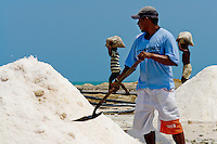 A Colombian worker shovels salt in the salt mines of Salinas de Manaure, Colombia, 12 May 2007. Manaure, the arid region in northern most part of South America (Guajira Peninsula), with its very hot and dry climate throughout the year and with the naturally formed lagoons, has always been favorable for the salt production. The salt explotation, run in this area by the Wayuu Indians and later by Colombian mestizos, is known since the pre-Columbian era. Although nowadays the salt production reach to one million tons a year, processed both by industrial and artisanal methods, no social or economical development has been marked in the local community. Sea salt industry in Manaure covers the major part of Colombia's salt consumption.