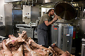 Charleston, South Carolina<br /> October 26, 2013<br /> <br /> Internationally renowned chefs, attending the Cook It Raw barbecue at Bowens Island.<br /> <br /> Chef PJ McMahon from the restaurants Aniar, EAT Gastropub and Cava Bodega in Galway, Ireland prepares 20 pig heads for the barbecue.