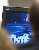 A photo of a hole cut in the trunk of the Cheverolet Caprice used by sniper suspect John Allen Muhammad is displayed on a screen in courtroom 10 at the Virginia Beach Circuit Court in Virginia Beach, Virginia on November 3, 2003.<br /> Credit: Lawrence Jackson - Pool via CNP