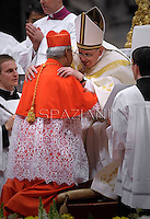 Cardinal Orlando B. Quevedo of Philippines  receives his beret as he is being appointed cardinal by Pope Francis  at the consistory in the St. Peter's Basilica at the Vatican on February 22, 2014.