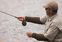 A man fly fishes in Michigan's Upper Peninsula.