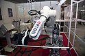 May 131, 2012, Tokyo, Japan - A industrial robot holds a metal bar. The Smart Grid Exhibition and Automotive Next Industry Fair 2012 shows the next generation of vehicles and manufacturing working with eco energy, from May 30th. to June 1st. at Tokyo Big Site.