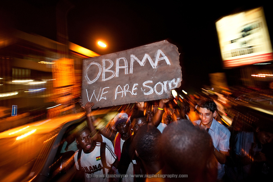 "A crowd bearing a sign reading ""Obama We Are Sorry"" marches down Oxford Street in Accra, Ghana as Ghanaians took to the streets to celebrate their win over the USA on 26 June 2010 during the FIFA World Cup."