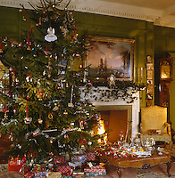 Christmas in the green panelled dining room before a roaring fire