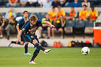 Brian Carroll (7) of the Philadelphia Union shoots and scores during the first half against the Columbus Crew. The Philadelphia Union defeated the Columbus Crew 3-0 during a Major League Soccer (MLS) match at PPL Park in Chester, PA, on June 5, 2013.