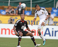 Jordan Graye #16 of D.C. United watches Sean Franklin #28 of the Los Angeles Galaxy head the ball during an MLS match at RFK Stadium on July 18 2010, in Washington D.C. Galaxy won 2-1.