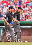 15 June 2016: MLB Umpire Dale Scott gives the safe sign after a play review during a game between the Chicago Cubs and the Washington Nationals at Nationals Park in Washington, DC. The Cubs fell to the Nationals 5-4 in 12 innings, giving up the rubber match of their 3-game series. Mandatory Credit: Ed Wolfstein Photo *** RAW (NEF) Image File Available ***