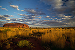 A cloud dotted sky over Uluru.