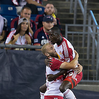 Foxborough, Massachusetts - September 16, 2015: In a Major League Soccer (MLS) match, the New England Revolution (blue/white) defeated New York Red Bulls (white/red), 2-1, at Gillette Stadium.<br /> Mike Grella celebrates his goal.