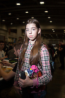 Megan Yancer, 11, from Frederick, MD, learned to play Magic: The Gathering with nine other family members, including three younger brothers and her grandmother. <br /> <br /> <br /> Danny Ghitis for Bloomberg Businessweek