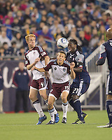 Former teammates battle for the ball. Colorado Rapids midfielder Jeff Larentowicz (4), Colorado Rapids midfielder Wells Thompson (15), and New England Revolution midfielder Shalrie Joseph (21). In a Major League Soccer (MLS) match, the New England Revolution tied the Colorado Rapids, 0-0, at Gillette Stadium on May 7, 2011.
