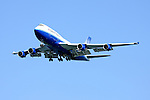 United Airlines Boeing 747-400 makes a gear down pass along the San Francisco waterfront during the 2009 San Francisco Fleet Week Air Show.