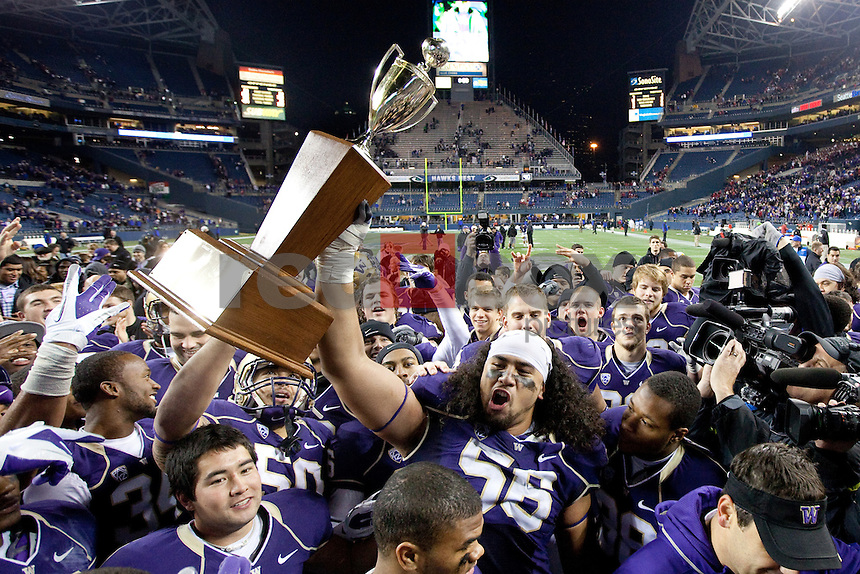 Senio Kelemete, Apple Cup Trophy. The University of Washington beat Washington State University to win the 2011 Apple Cup 38-21 at Century Link Field in Seattle on Saturday November 26, 2011 (Photography By Scott Eklund/Red Box Pictures)