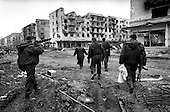 Grozny, Chechyna.1995.A team of interior ministry troops are guided by a woman resident into an apartment complex where she believes there is a Chechen sniper.