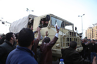 Protesters at Tahrir Square on 29 January greet the Egyptian army while calling for the ouster of President Hosni Mubarak.
