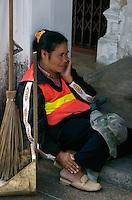 Street Cleaner talking on Cellphone, Phuket