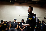 These Guatemalan police are responsible for transporting criminals to and from prison, at the Supreme Court of Justice, in Guatemala City, on Tuesday, March 20, 2012.