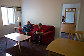Los Angeles, California<br /> January 29, 2014<br /> <br /> Former homeless WWII veteran Ivan Bennett, 85 was placed in a VA voucher apartment a few days before he receives donated furniture. His VA case worker William Kurts is present as the furniture arrives and they both try out the new couch as the new bedroom mirror is put into place.