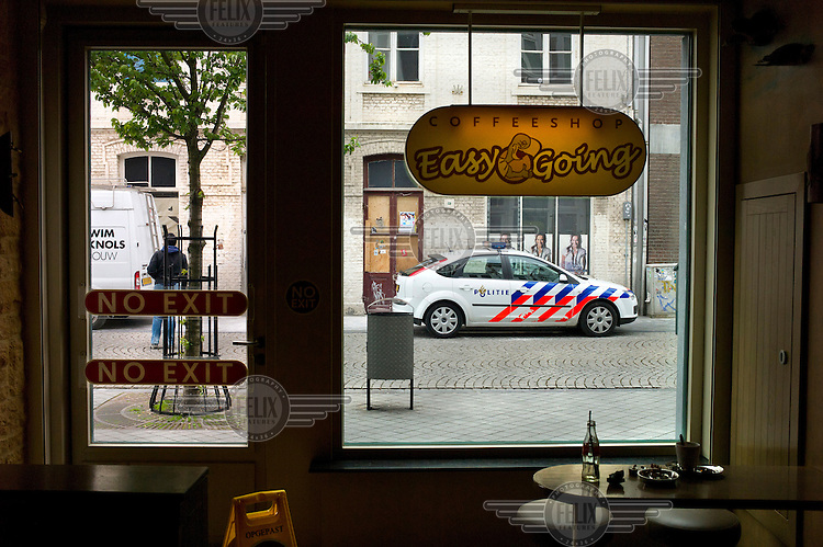 A police car parked outside the Easy Going coffee shop in Maastrciht.